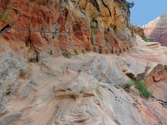 Chains assist narrow sections with steep drop offs on the Hidden Canyon Trail